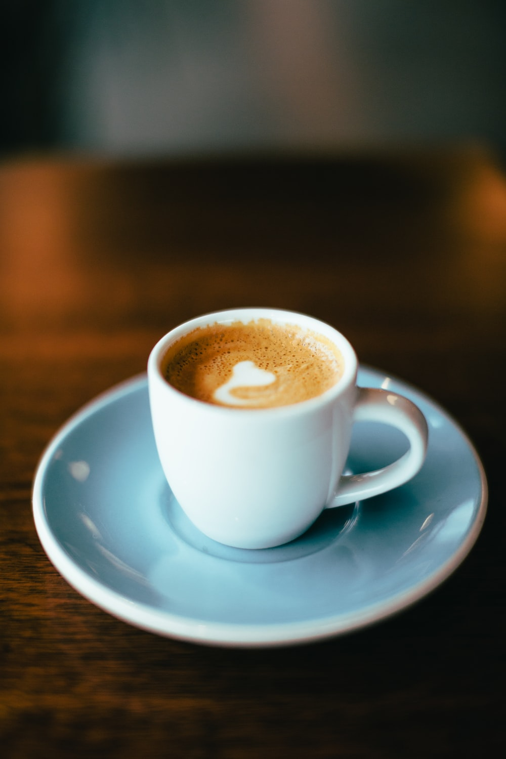selective focus photography of latte in teacup