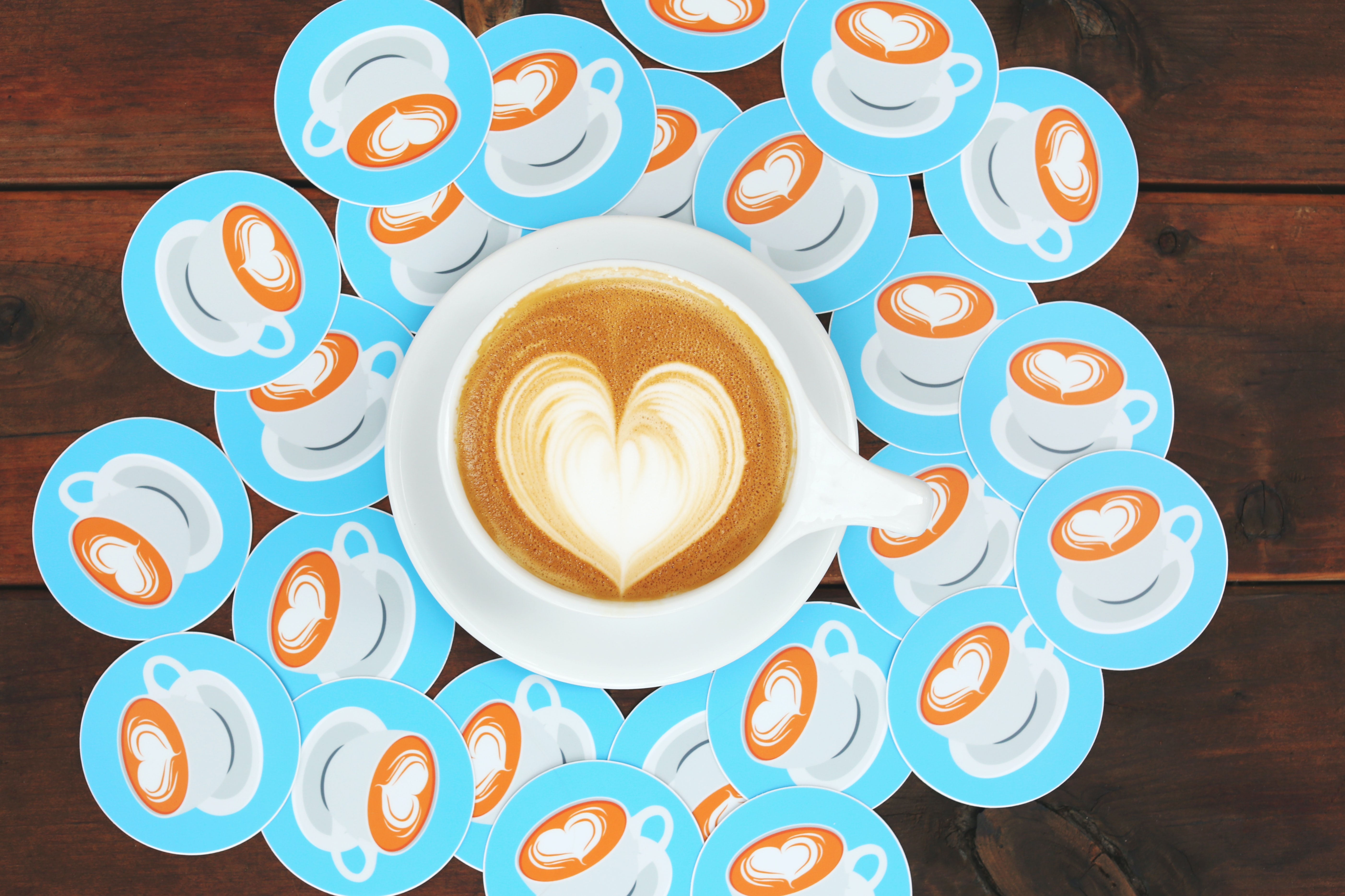 A cup of coffee with latte art in the shape of a heart