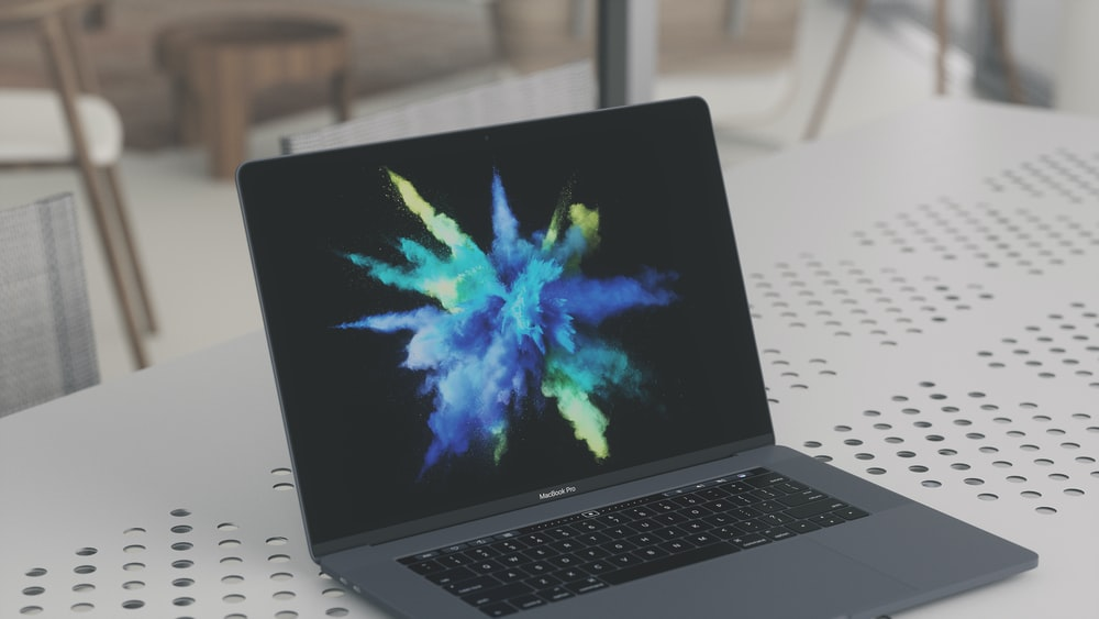 MacBook Pro on white metal surface