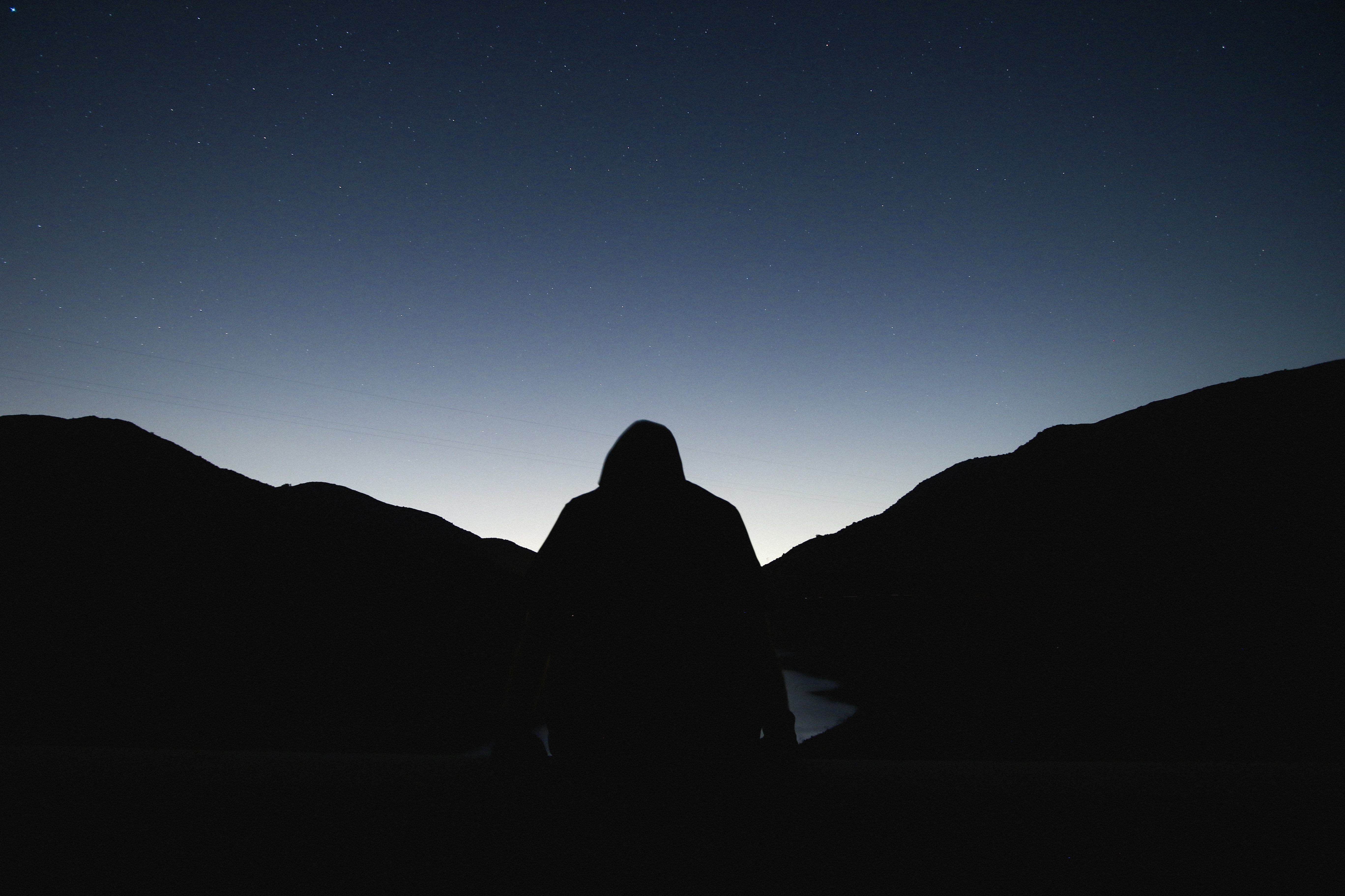 silhouette of a person facing sunrise