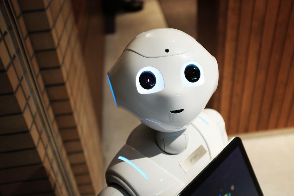 white robot near brown wall
