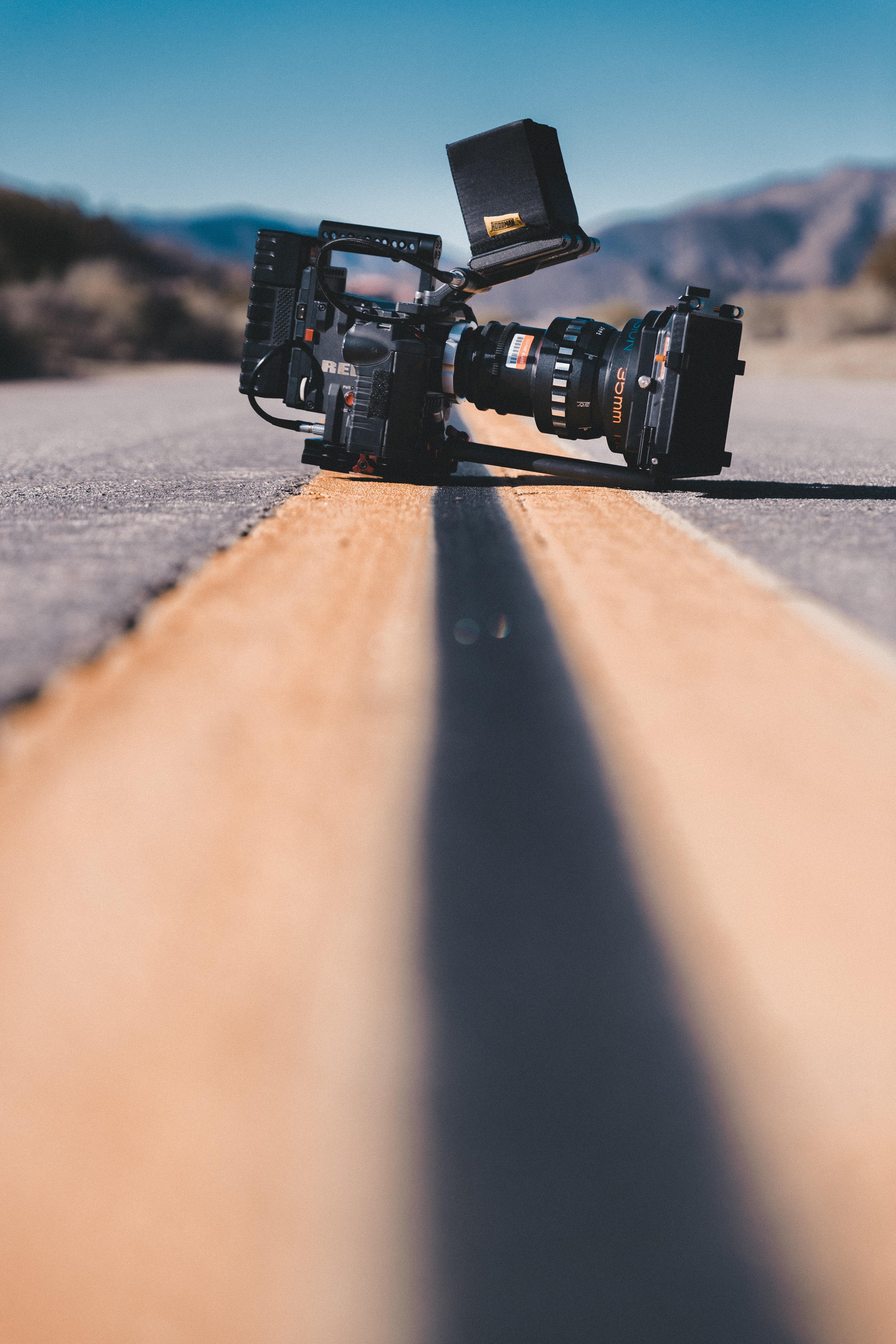 black shoulder-held camcorder on road