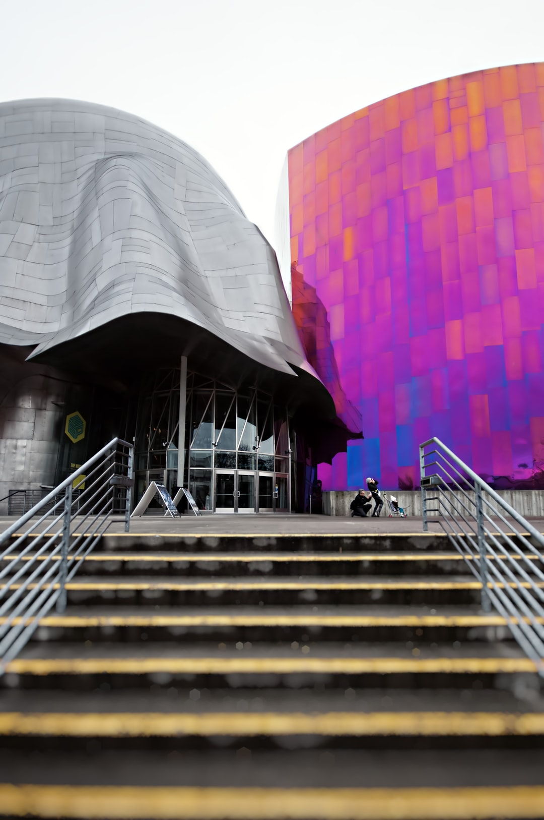 Look at the gesture of this family as they are inspired to take some photos of the Experience Music Project Museum.