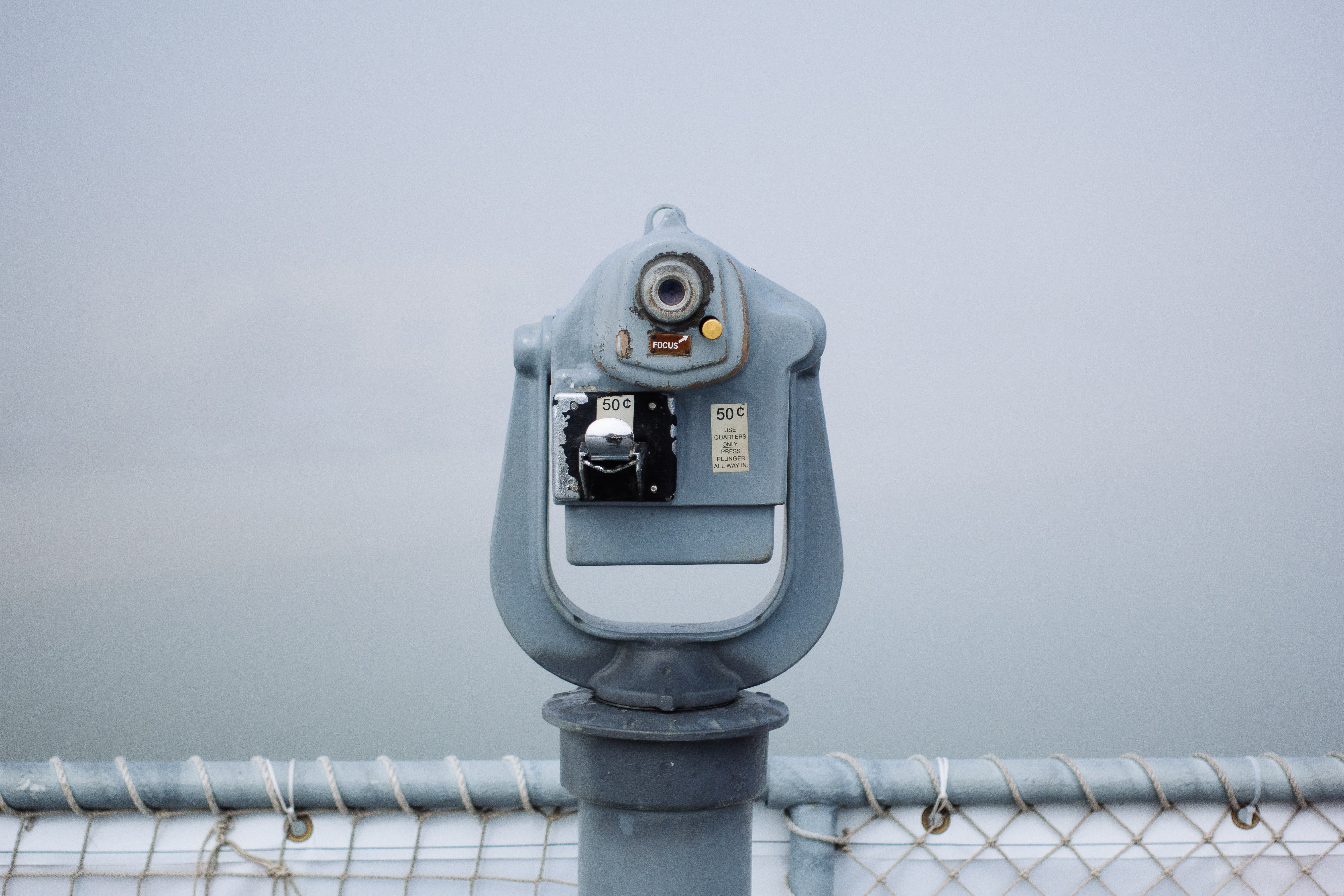 A tower viewer at the edge of an observation deck on a misty day