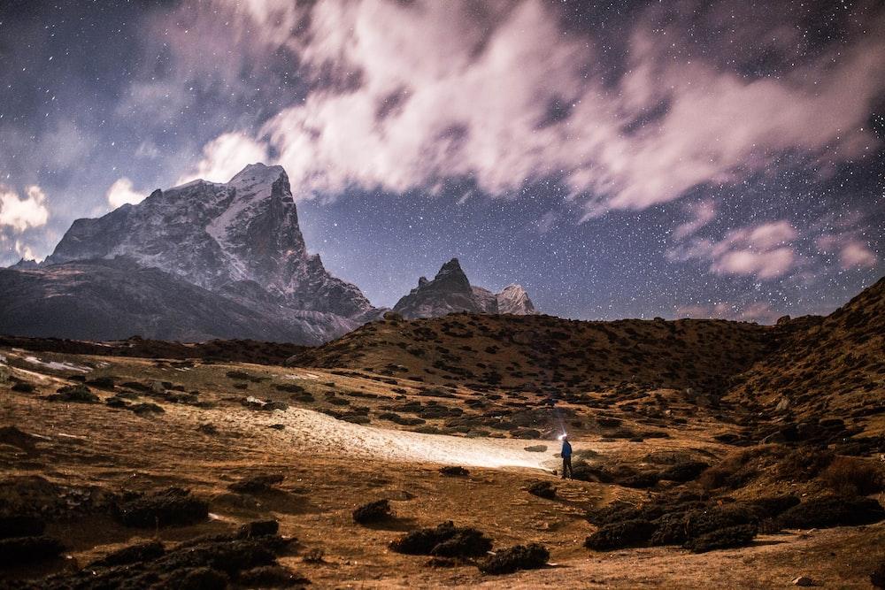 person on land near on mountain