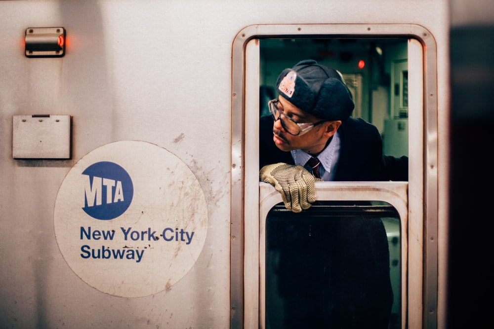 man peeking on new york city subway train window