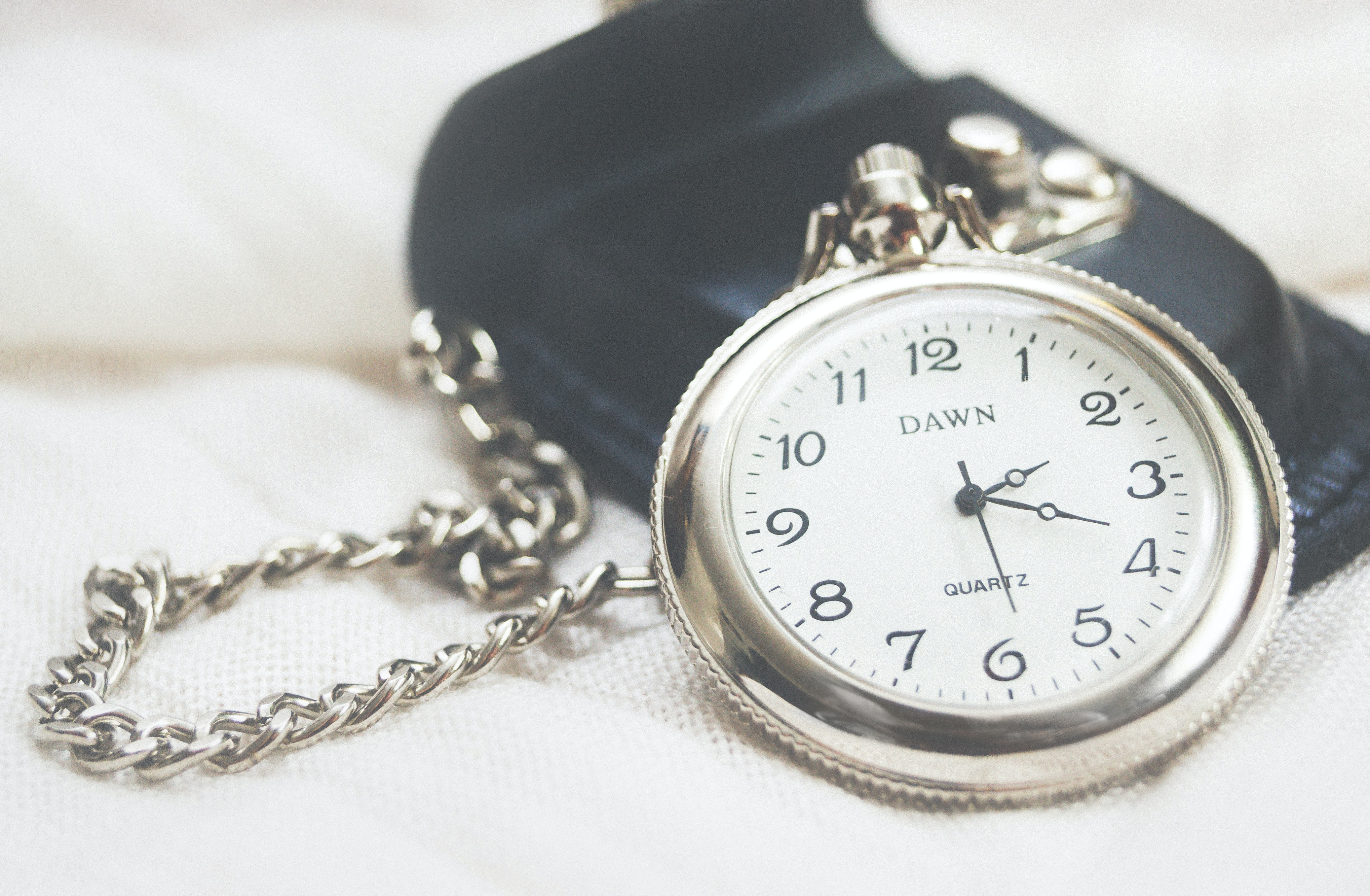 round silver-colored Dawn analog pocket watch