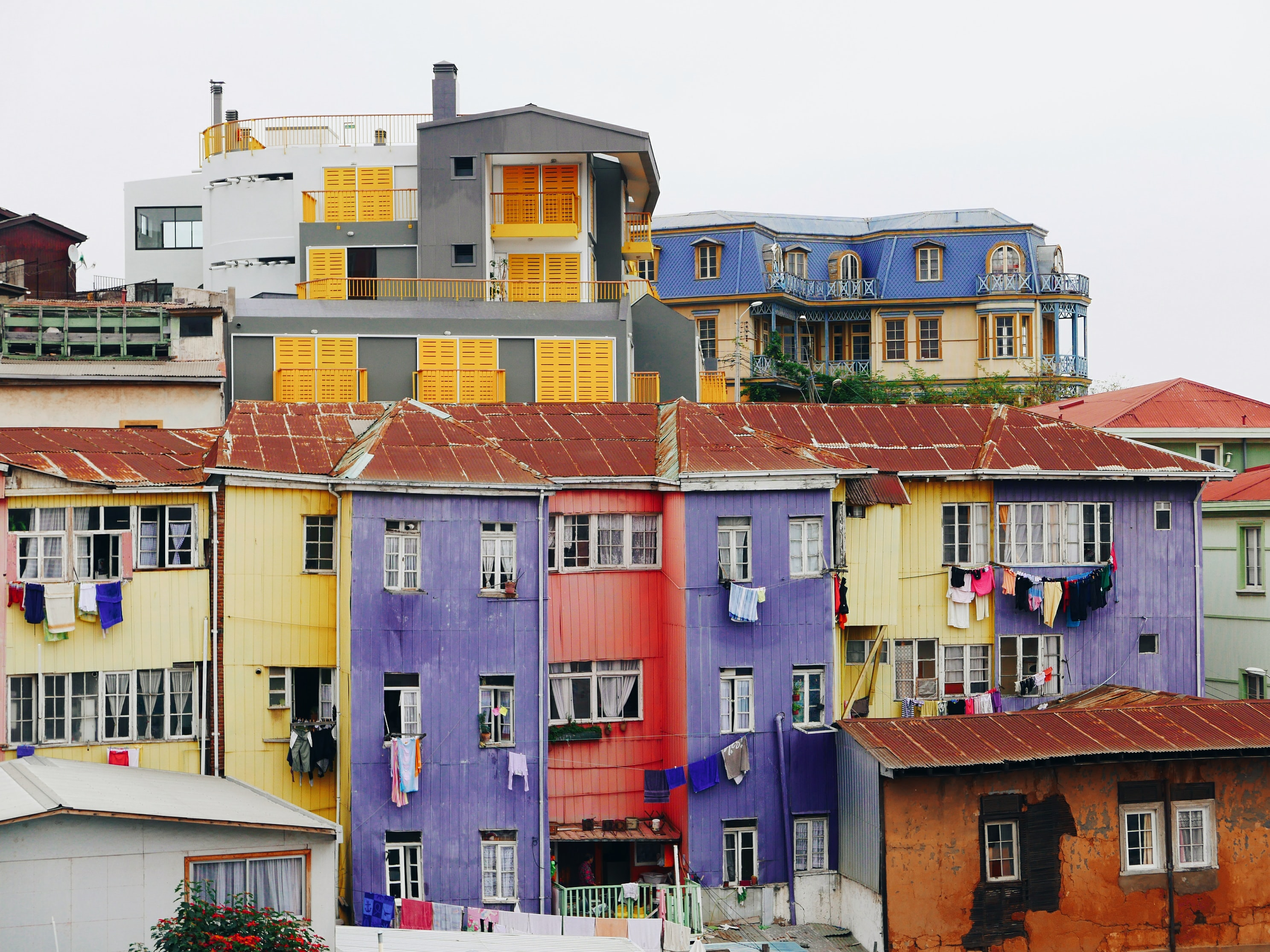 assorted-color concrete buildings under white skies