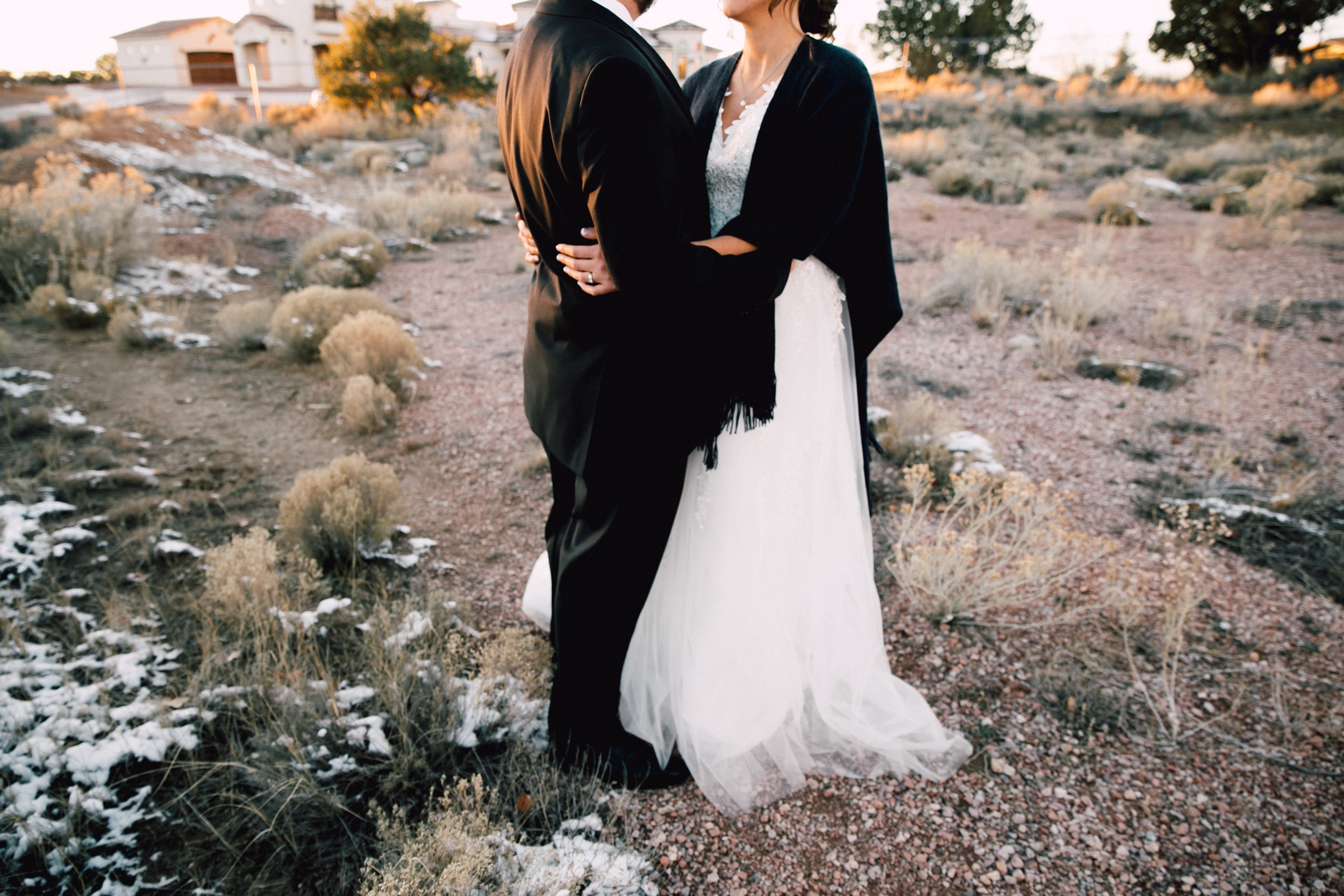 Bride and groom hold each other in Gallup at sunset