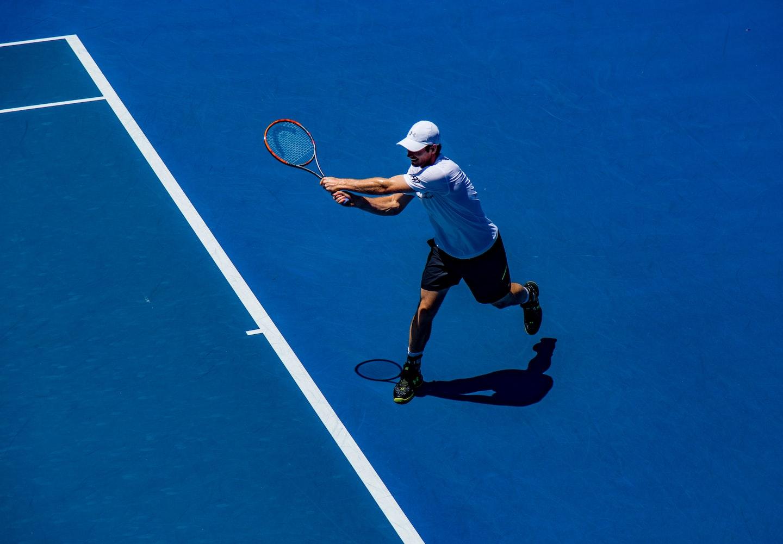 Man wearing a cap while playing tennis