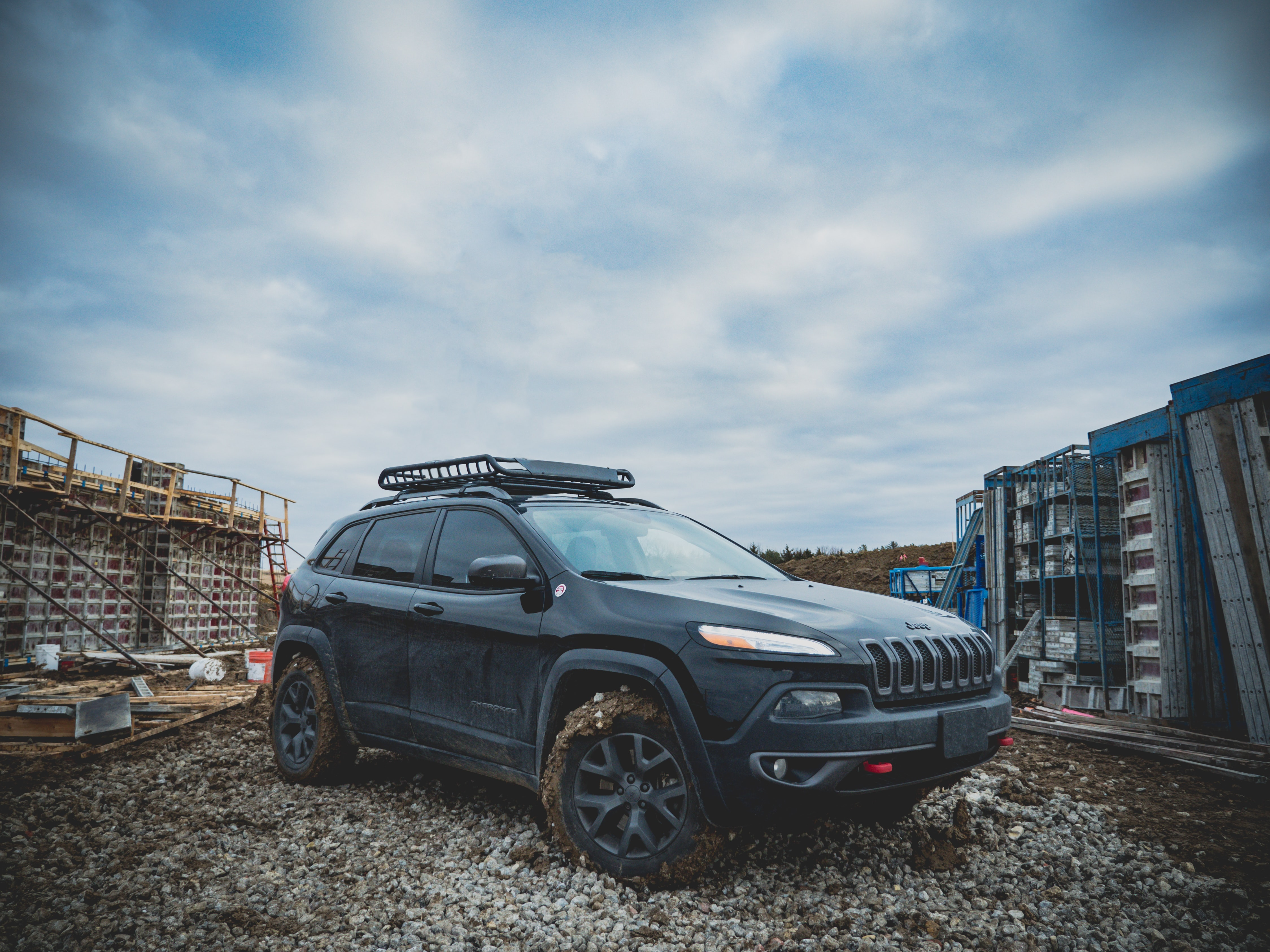 A 4x4 with muddy tires is parked in the middle of a construction site in Lincoln.