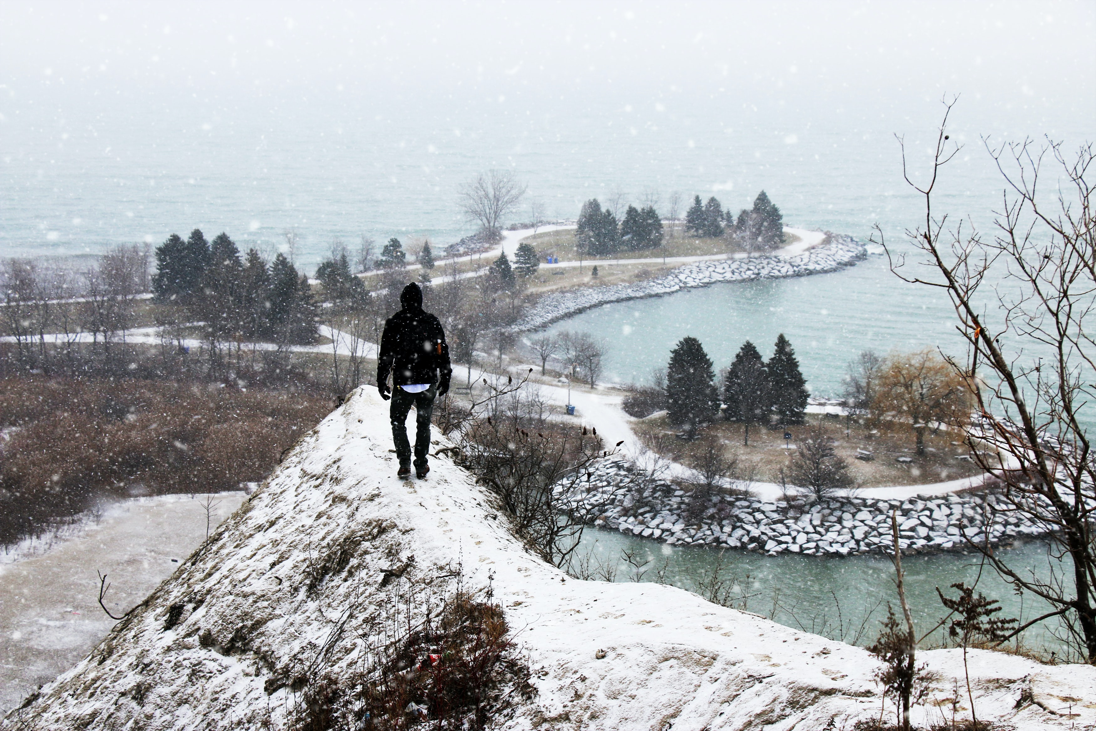 A person walking on a narrow path at Scarborough Bluffs