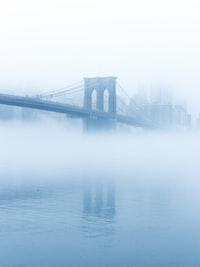 Brooklyn bridge surrounded by fog