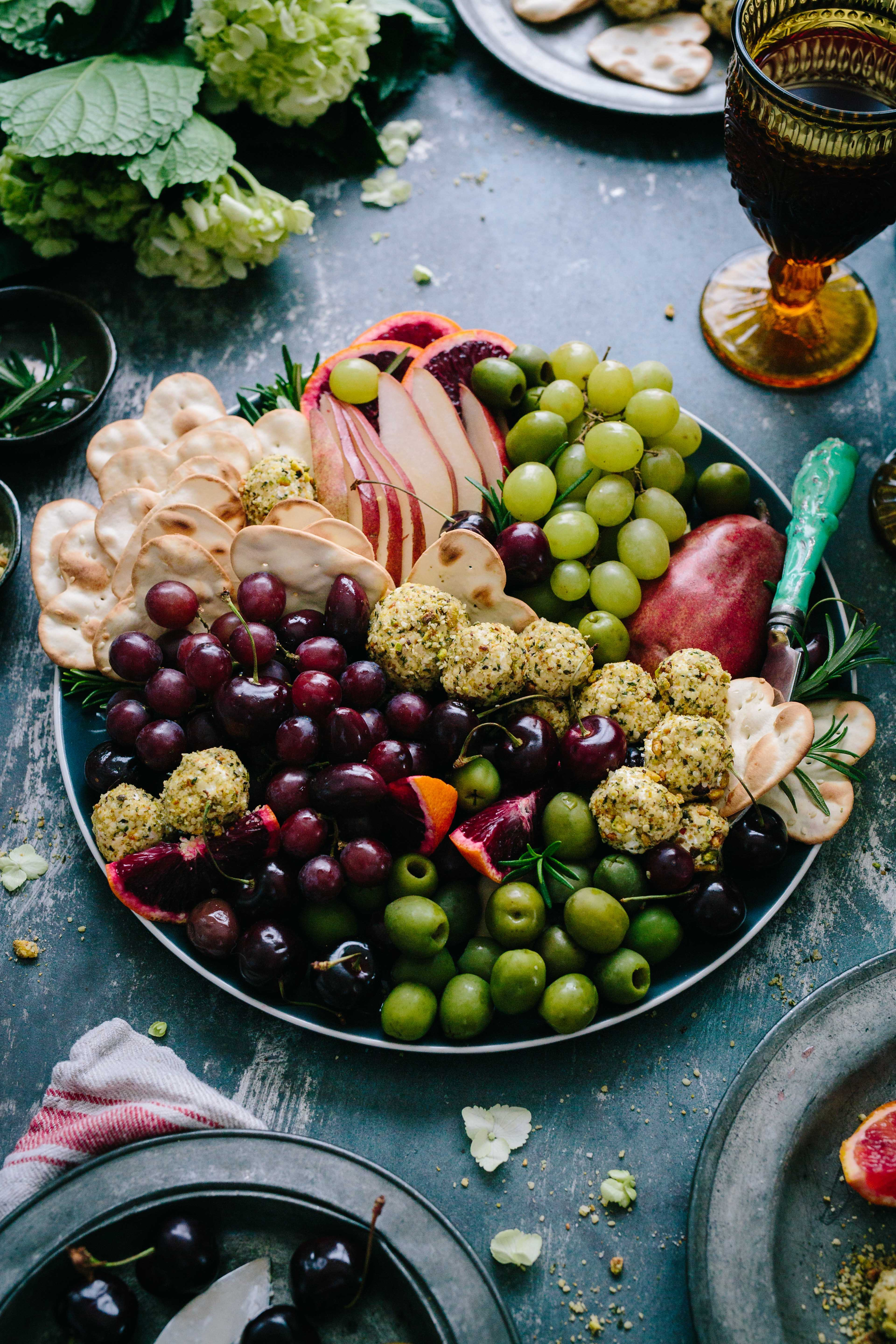 A large plate of grapes and olives.