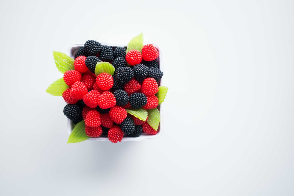 bowl of red and black berries