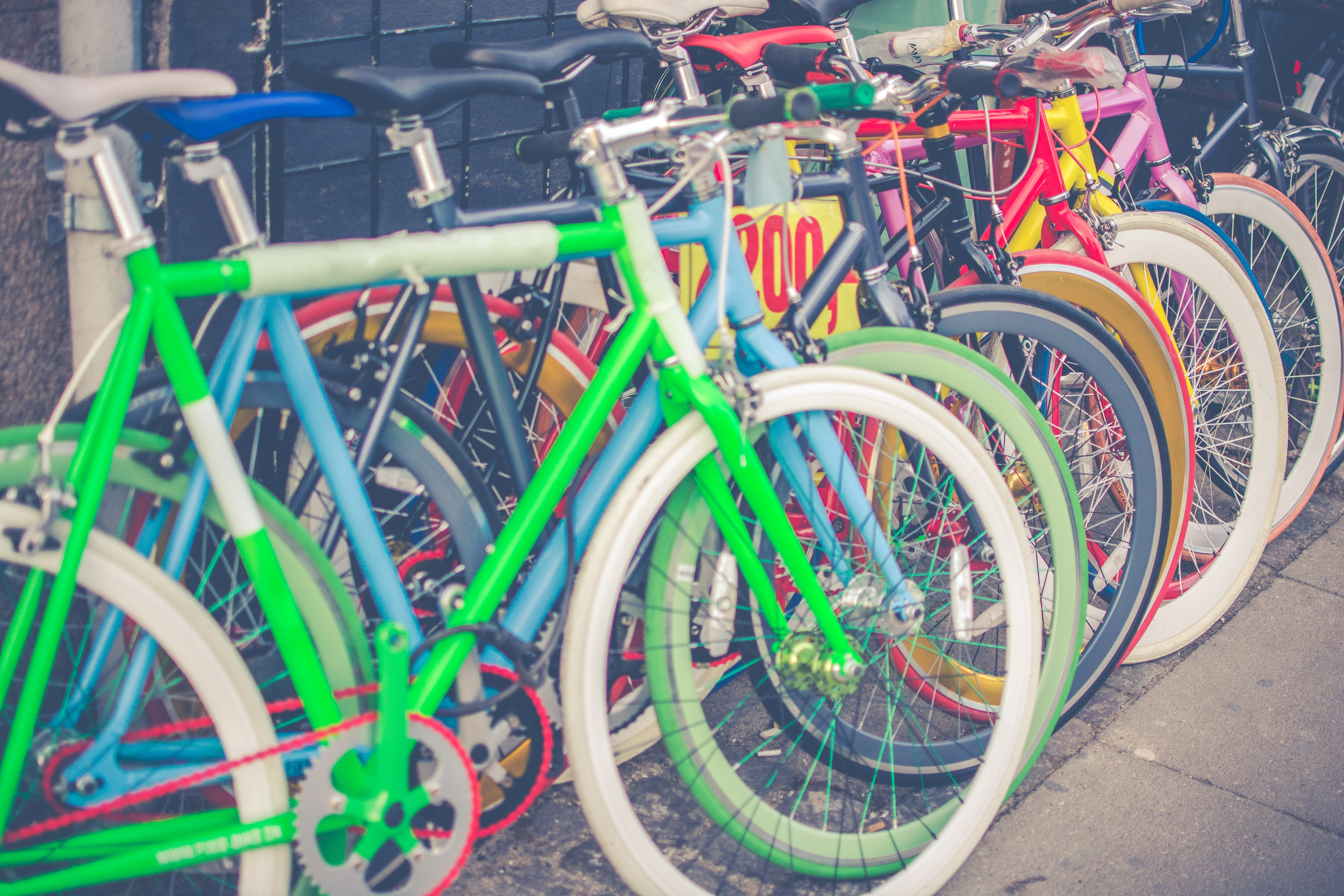 photo of assorted-color bicycles on gray pavement