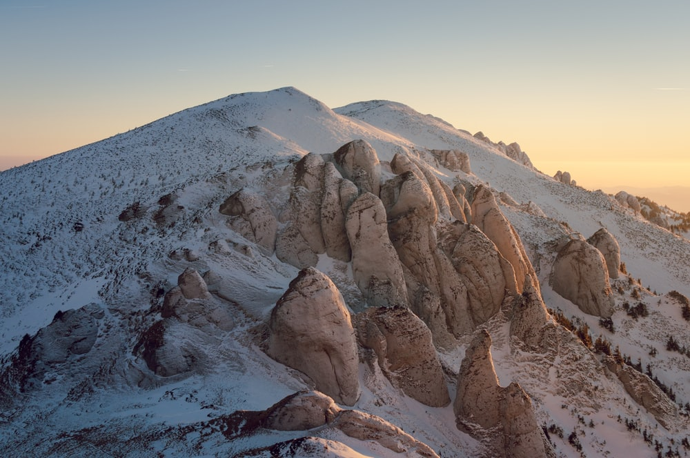big rock formations covered with snow