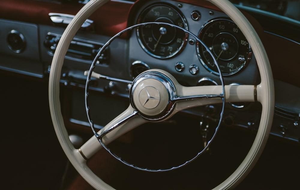 brown Mercedes-Benz steering wheel