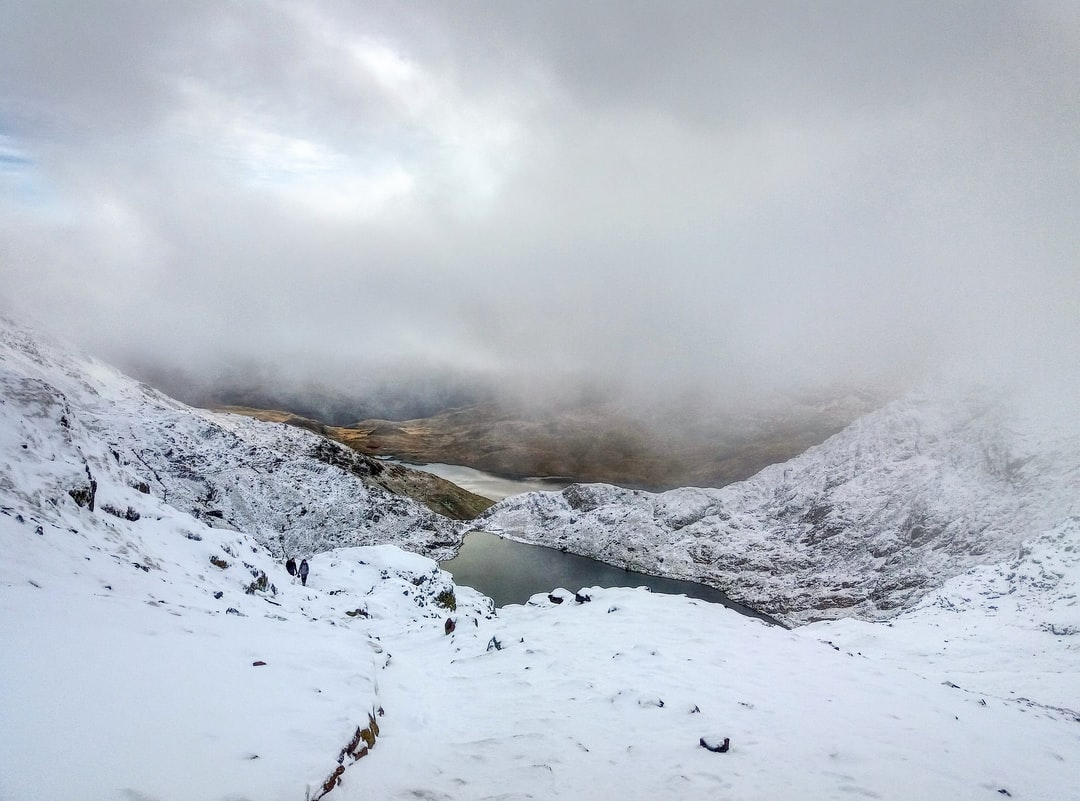 Climbing the highest peak in England and Wales, the ascent took us through the clouds and into the snowy cap of Snowdon