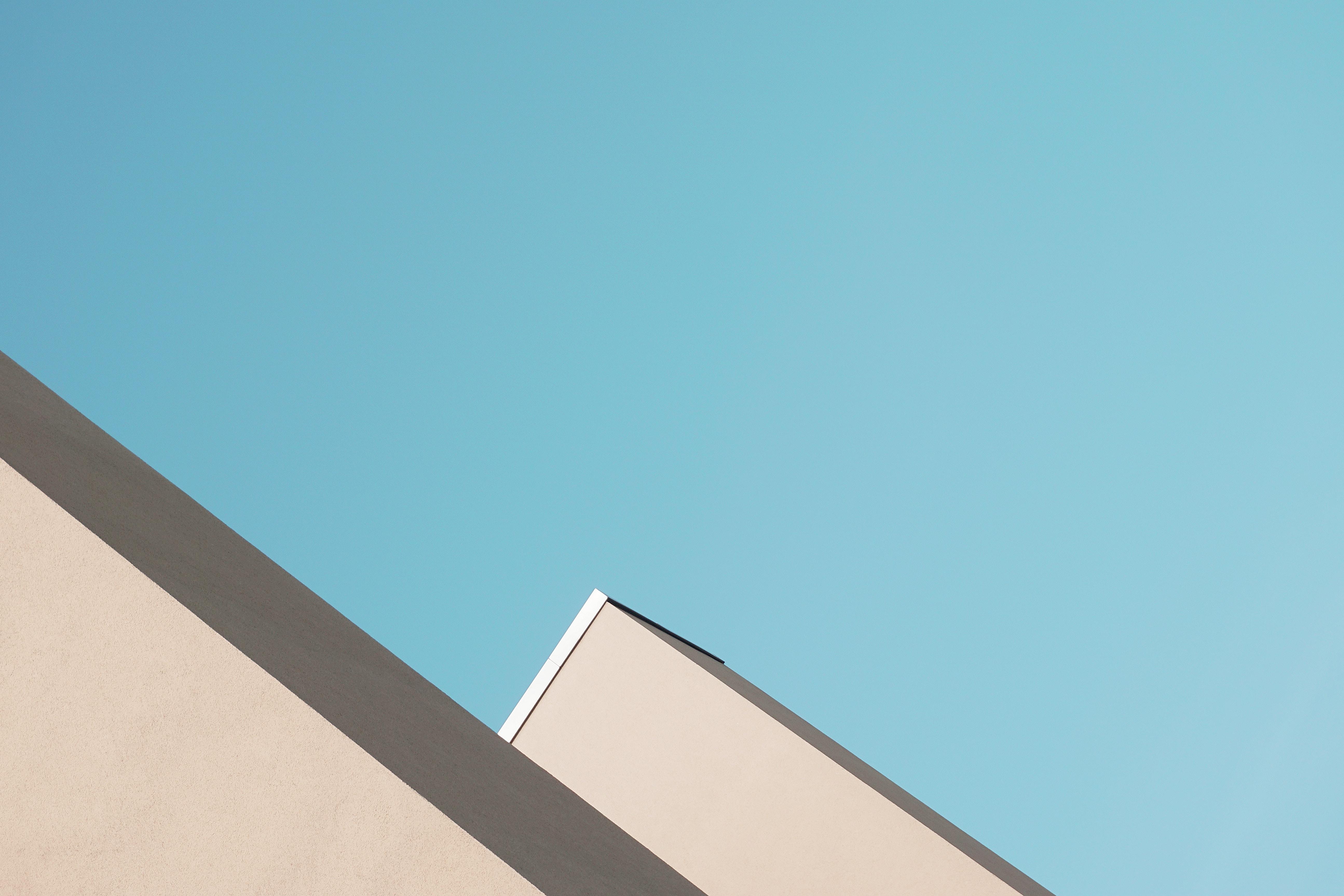 beige painted building under blue sky