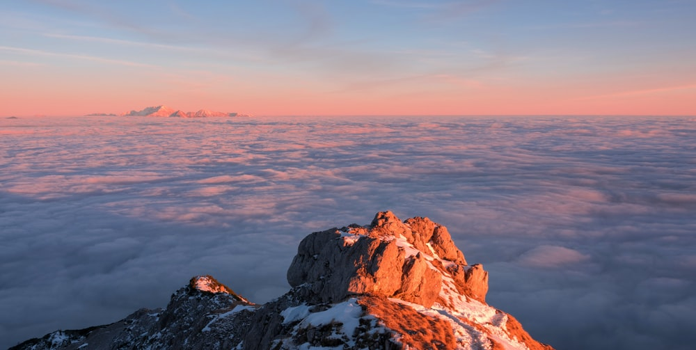 glacier mountain near clouds during golden hour