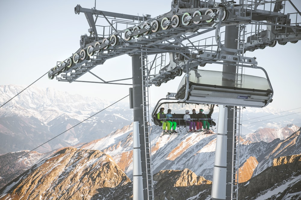 group of people riding white ski lift