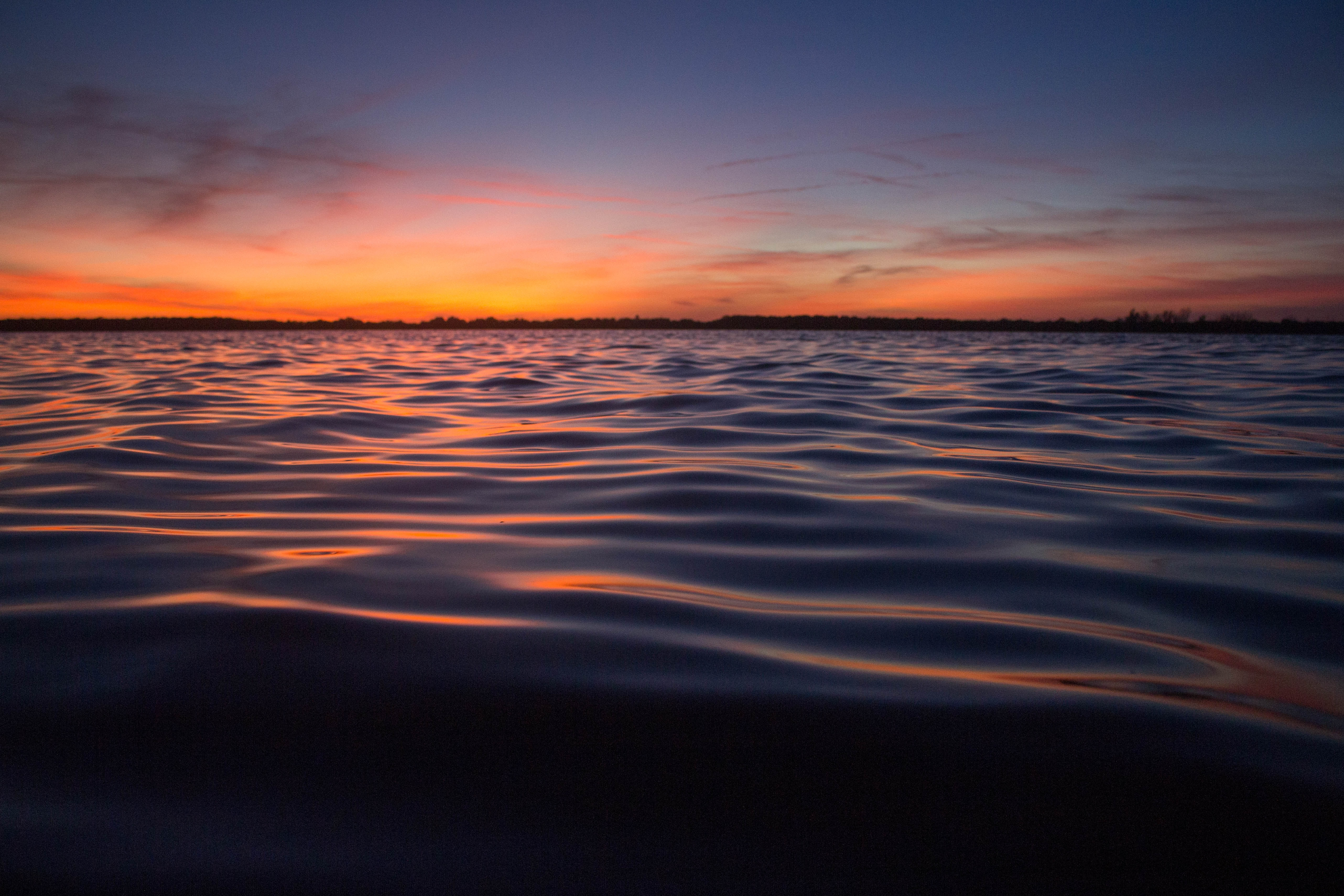 body of water during golden hour landscape photography