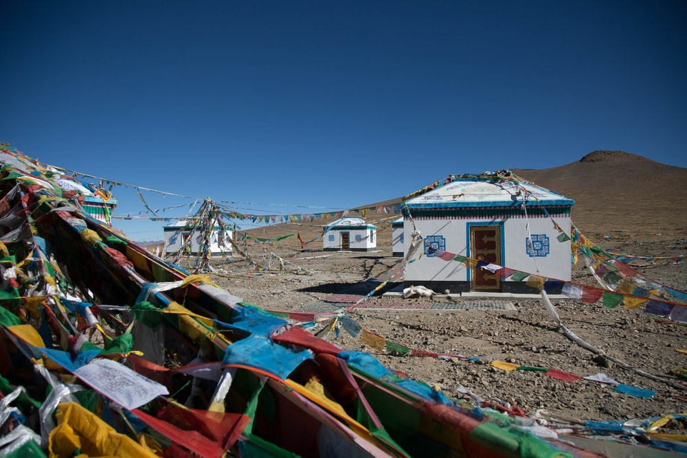 Blue and white Mount Everest Base Camp houses with streamers running between them