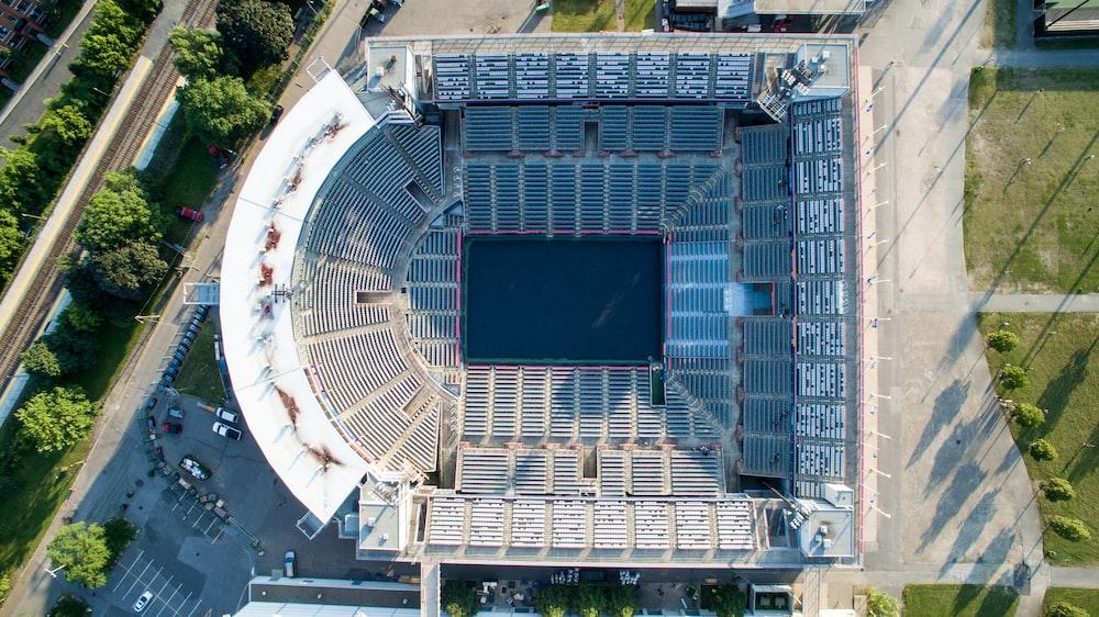 aerial photography of grey concrete stadium