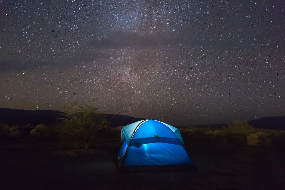 blue tent under starry sky