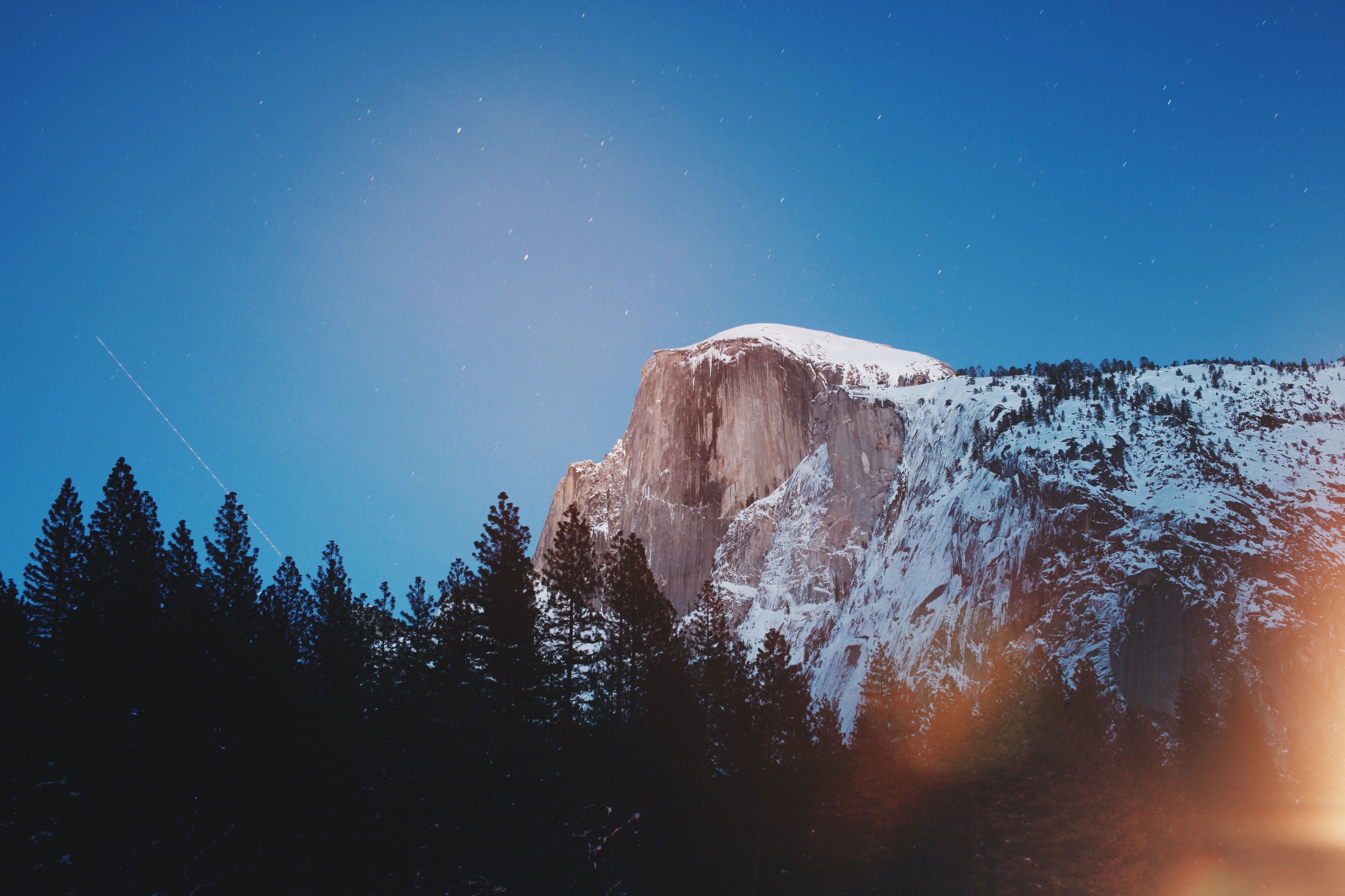 The Half Dome summit in Yosemite Valley under starry evening sky