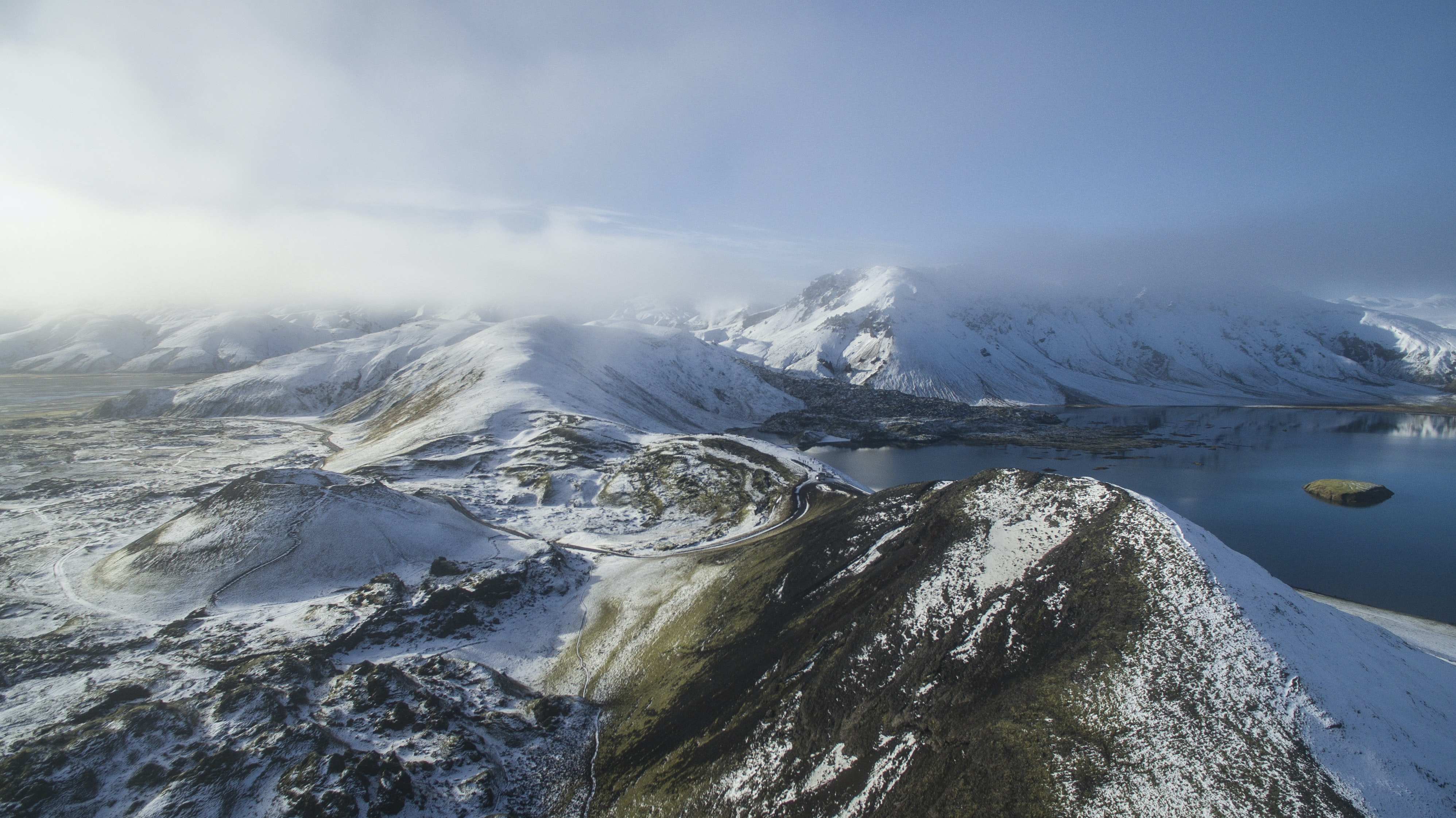 aerial view photography of snow mountain near lake