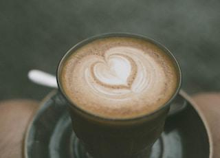 closeup photo of ceramic coffee mug with brown liquid inside