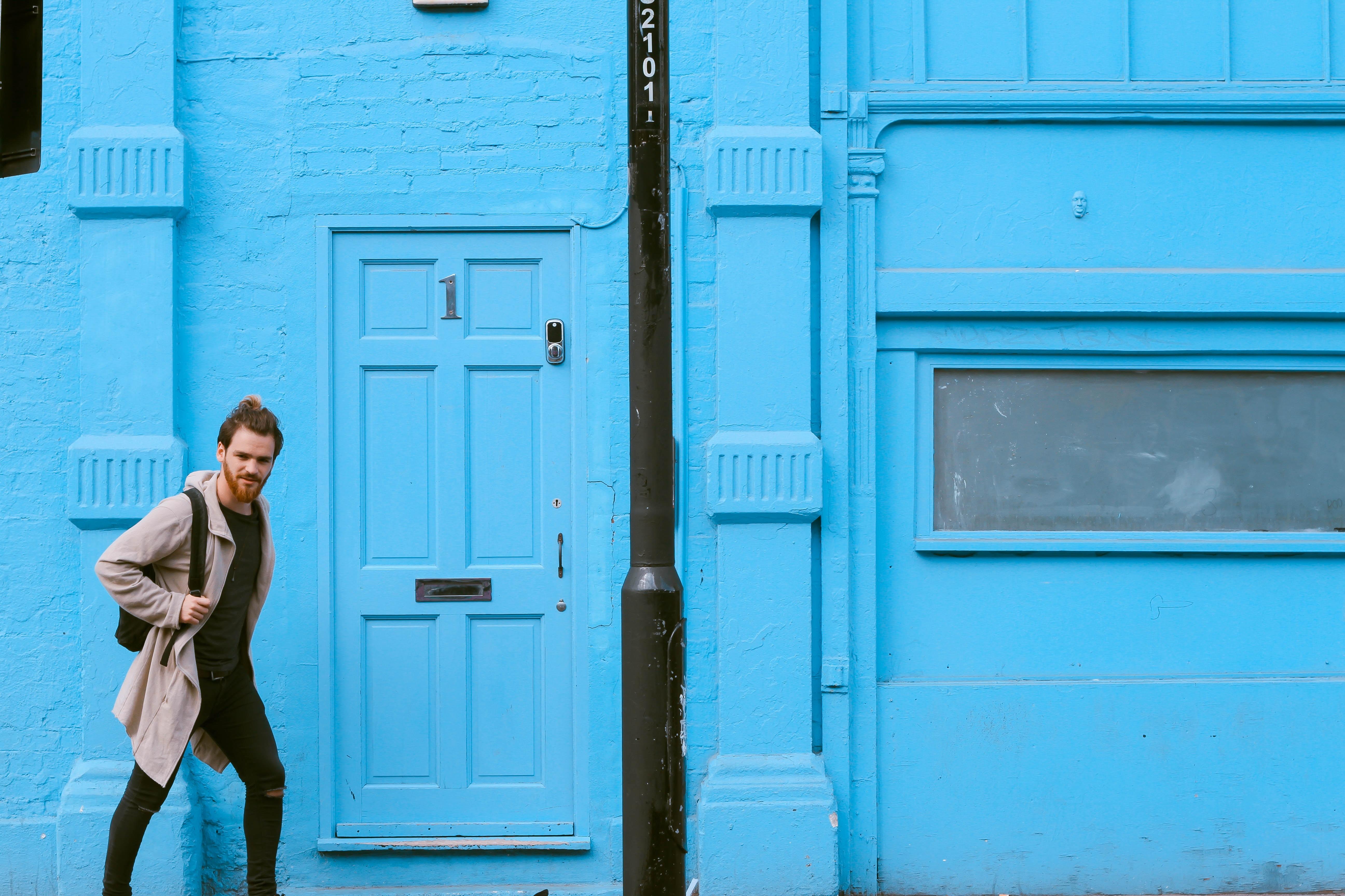 man passing through the door during daytime