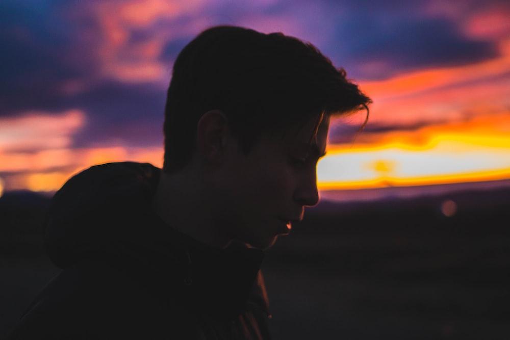 silhouette of man during sun set