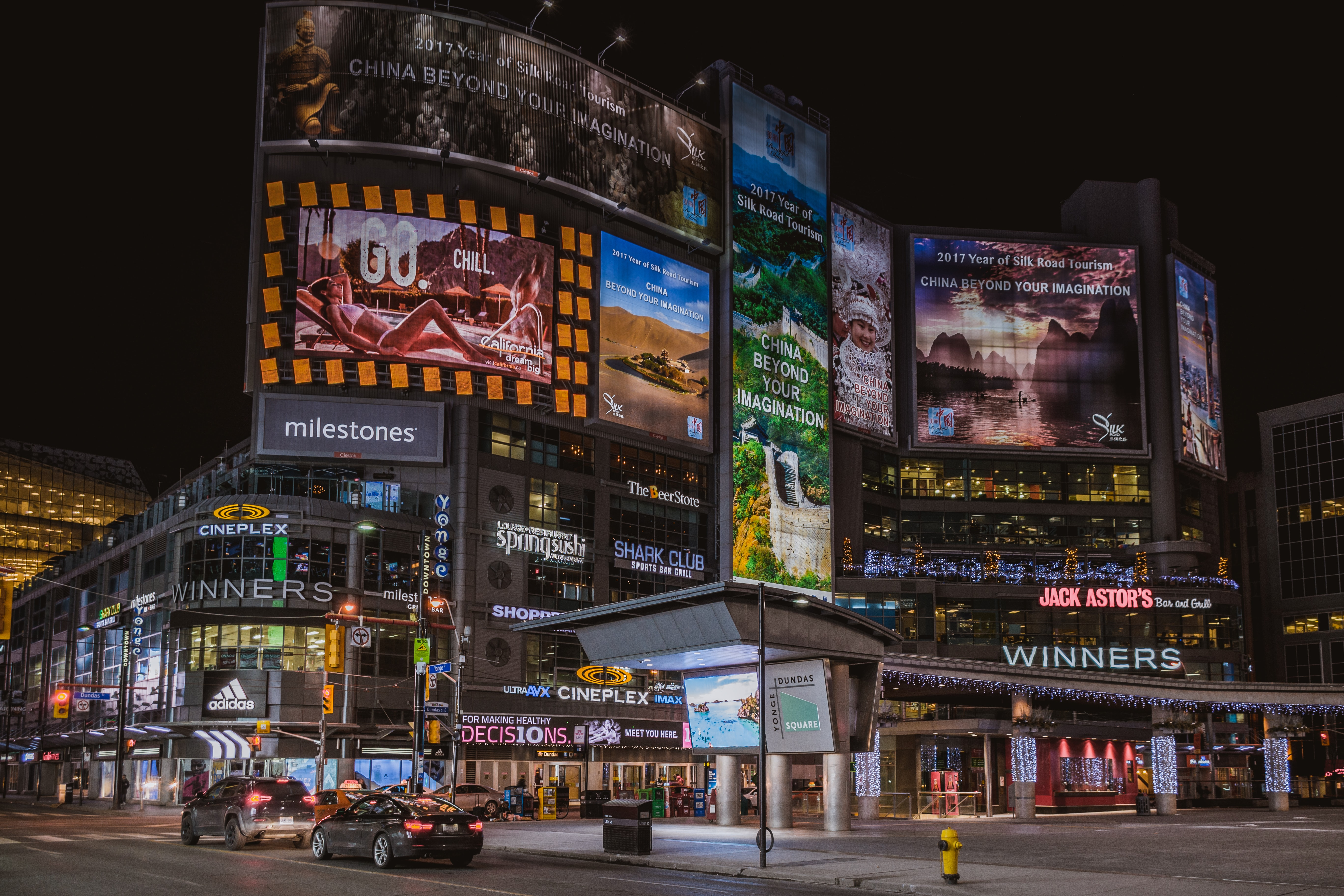 Neons and advertisements in a square in Toronto at night