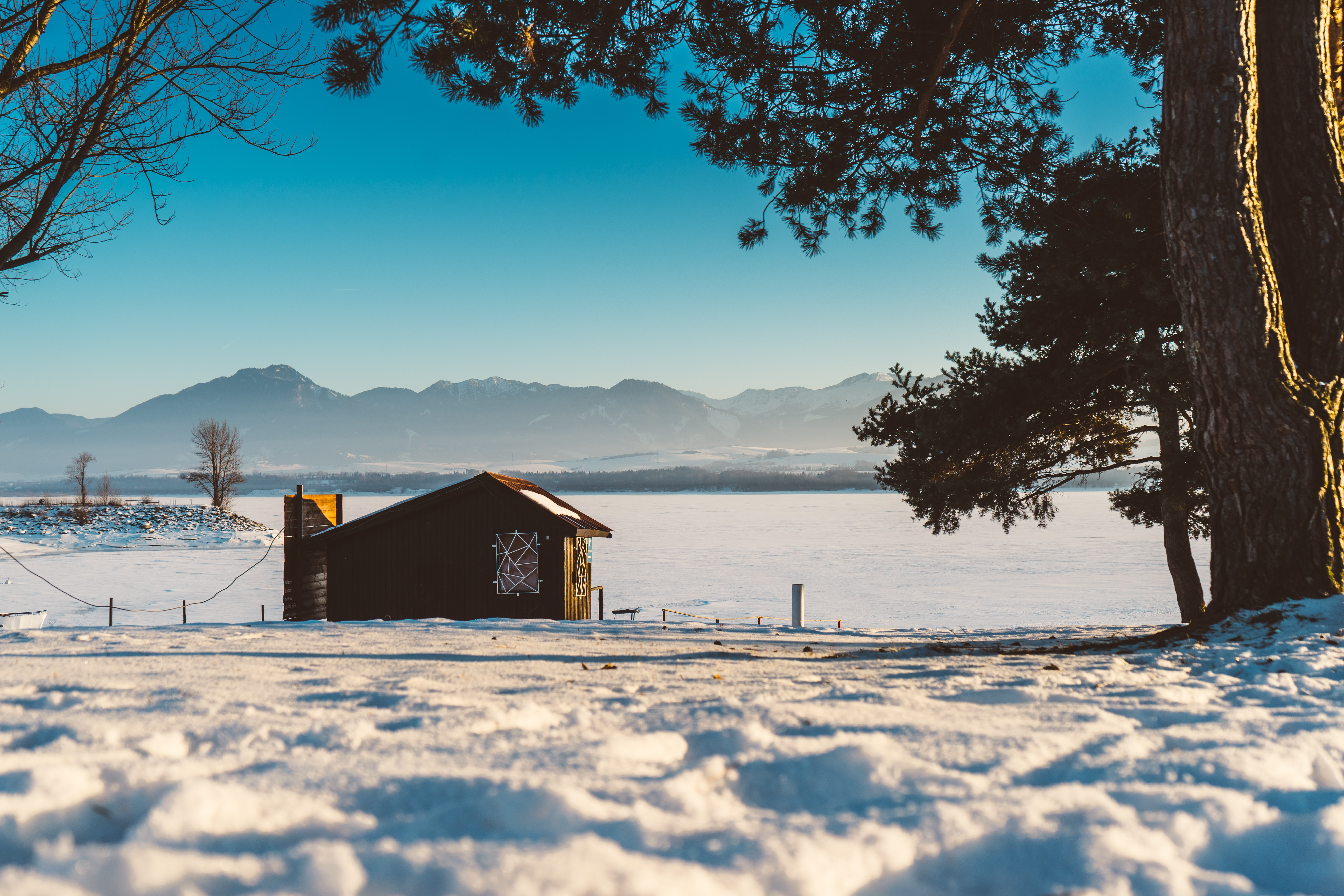 A winter shot of a shack at the bottom of mountains in Liptovský Trnovec, Slovakia