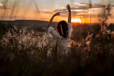 Woman yoga pose sunrise