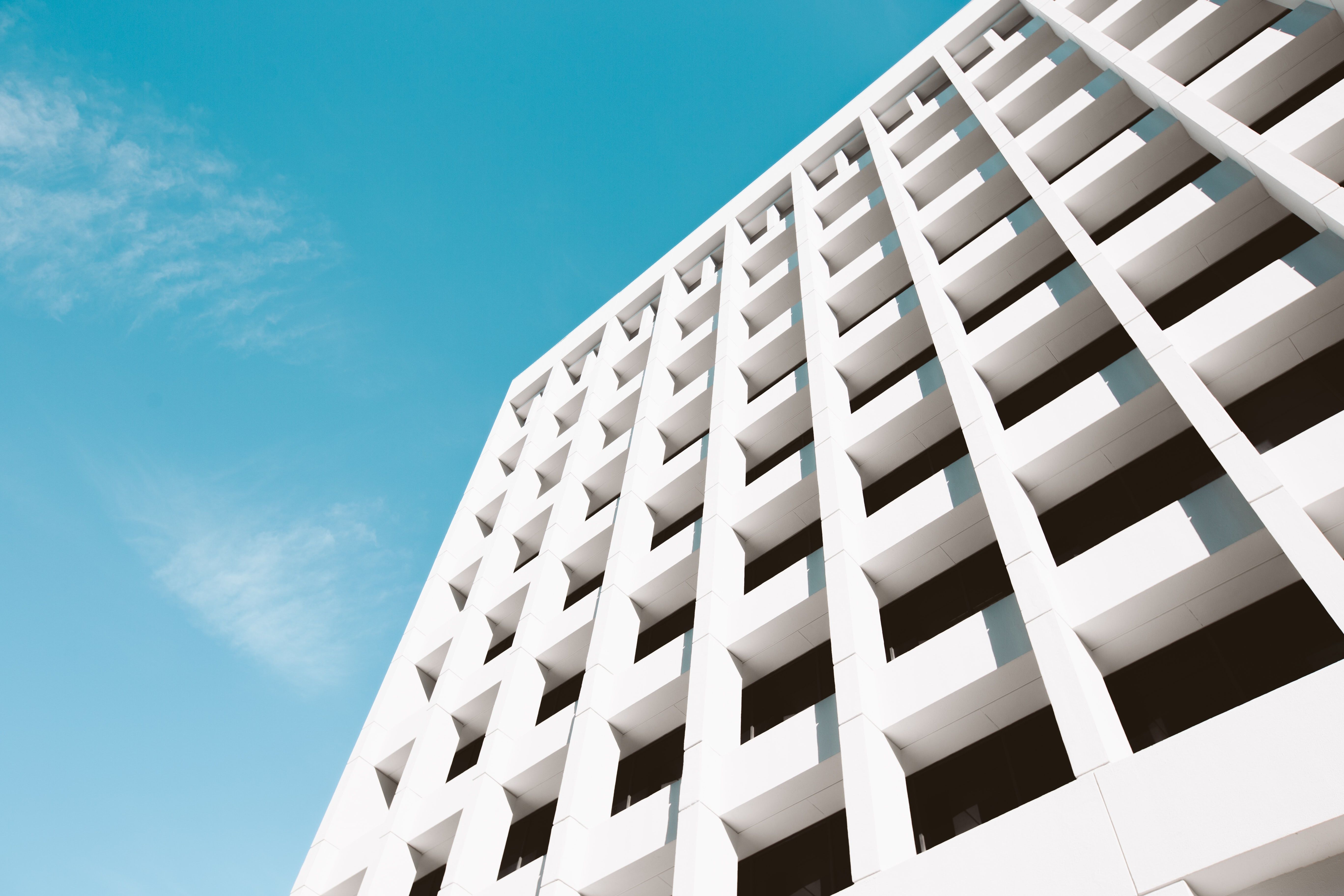 A white building facade with a cruciform pattern