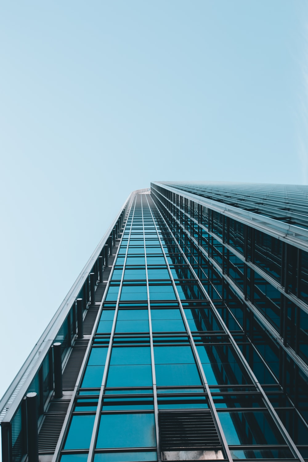 low angle photography of clear glass high-rise building