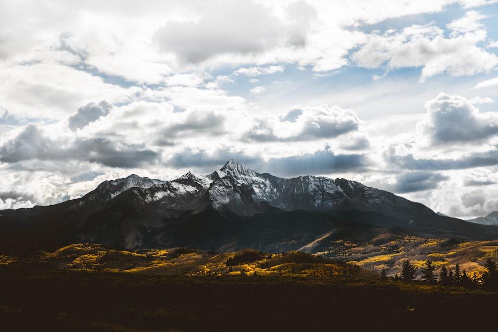 silhouette of mountain under white sky