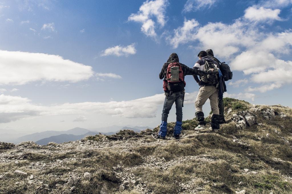 thru-hikers on hilltop during daytime