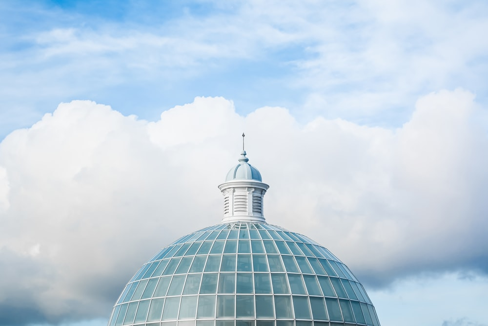 green and white dome tower under white and blue sky at daytime