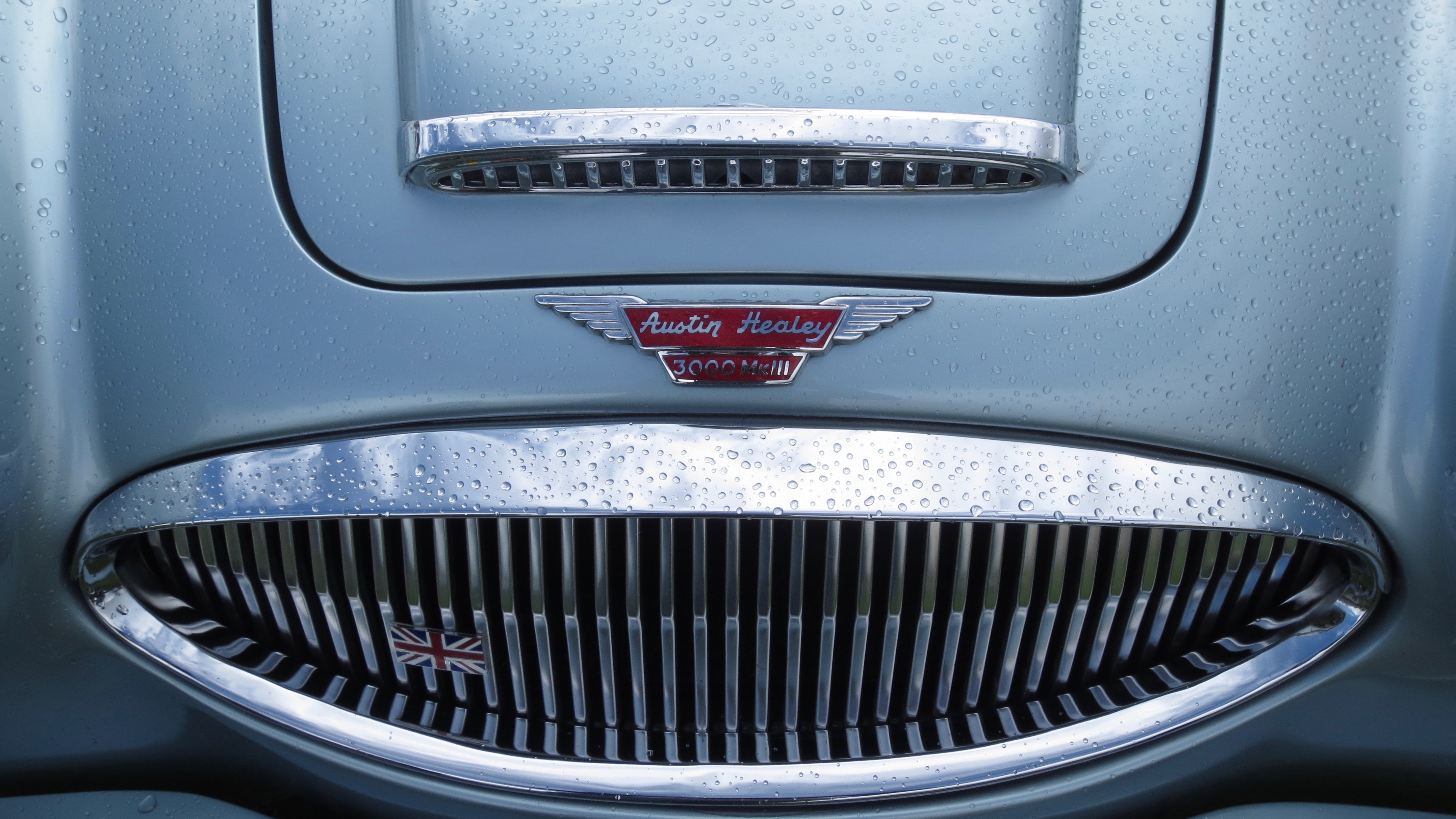 Close-up view of an Austin-Healey chromed front grille