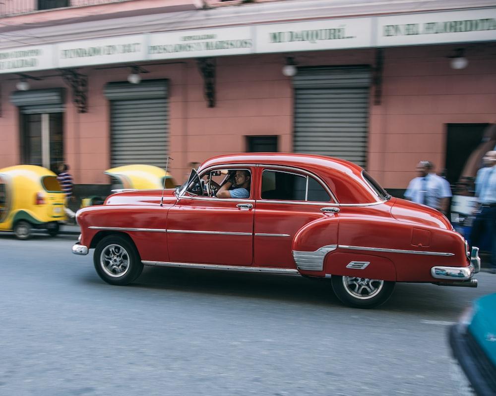 red sedan on the road