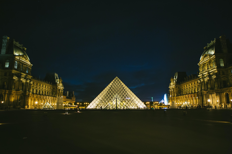 The Louvre Museum pyramid illuminated at night