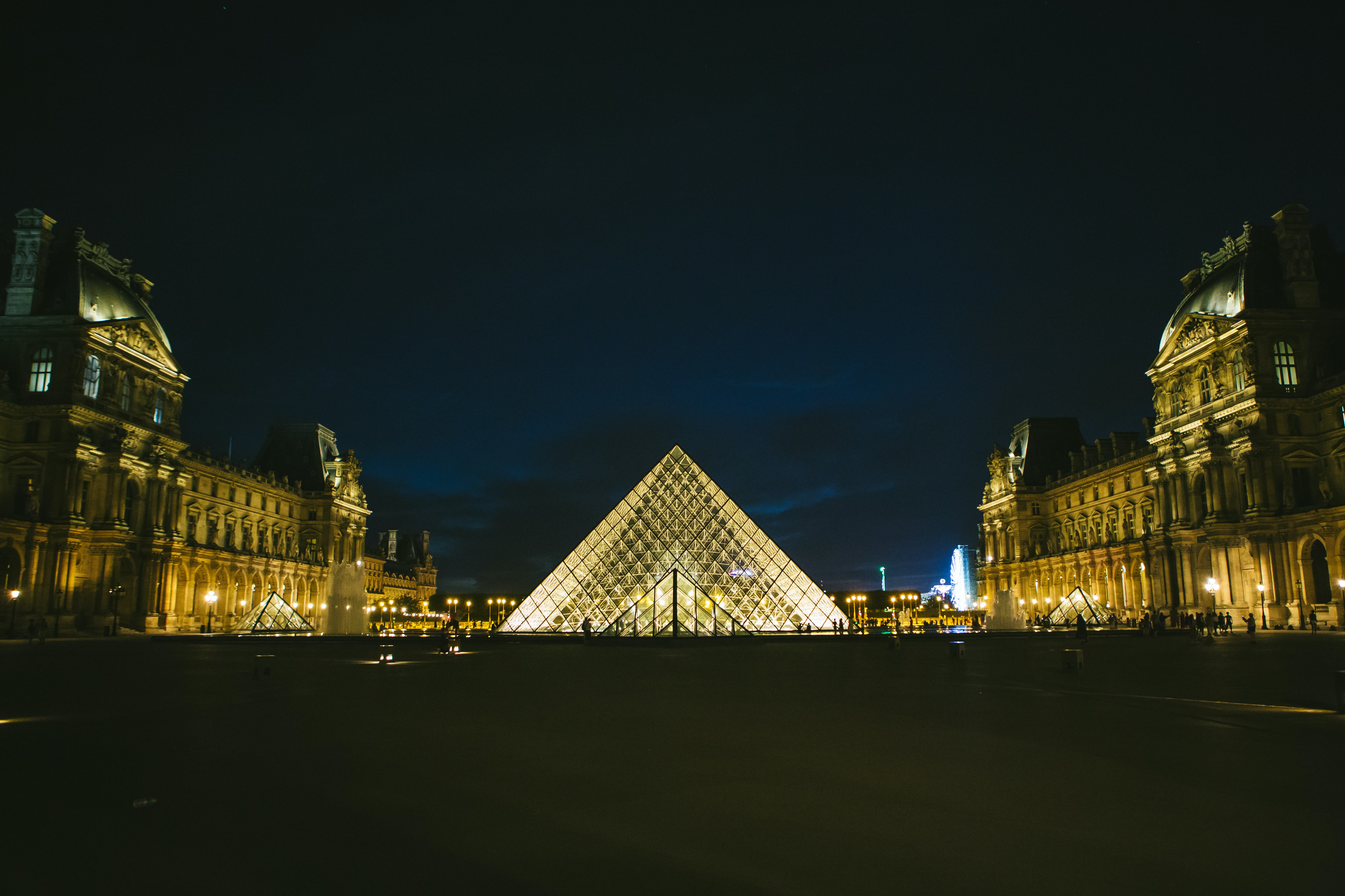 The Louvre Museum pyramid illuminated at night