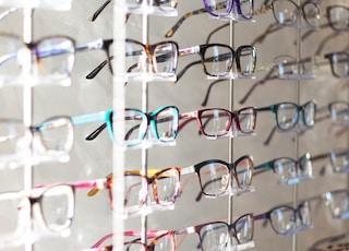 arranged assorted-color eyeglasses on rack