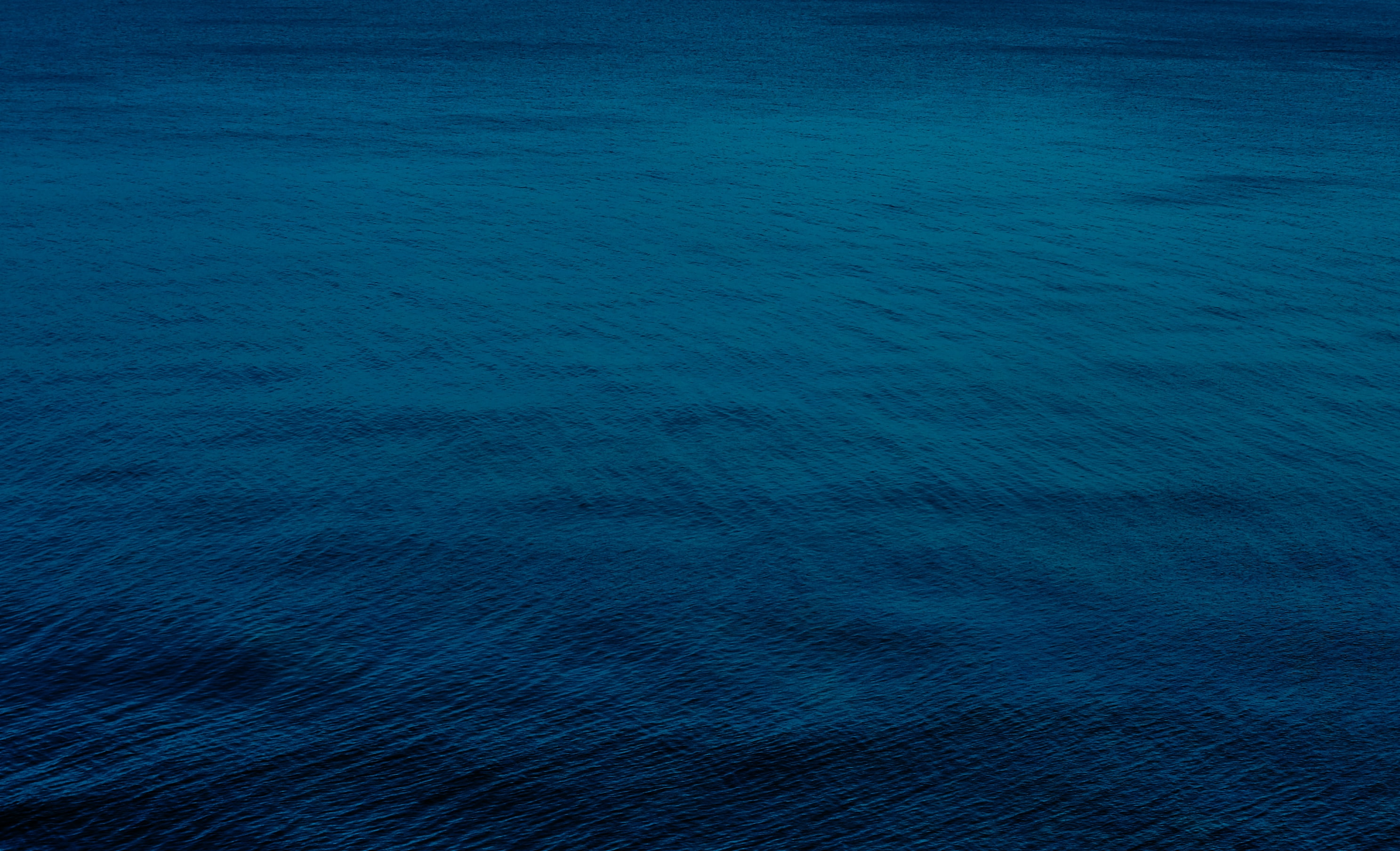 selective focus photography of blue water