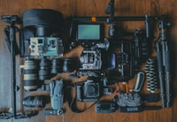 flat lay photography of cameras and camera gear